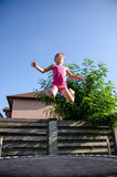 Happy girl on a trampoline Stock Photo