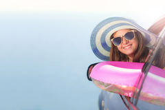 Happy girl  travel by car to the sea. Royalty Free Stock Image