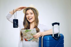 Happy girl traveler holding paper map with camera. Stock Photo