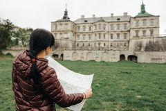 Happy girl traveler on vacation with map of landmarks Stock Photo