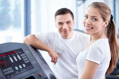 Happy girl on treadmill Royalty Free Stock Photography