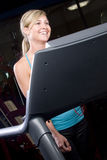 Happy girl on a treadmill Stock Image