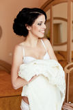 Happy girl tries on a wedding dress Royalty Free Stock Images