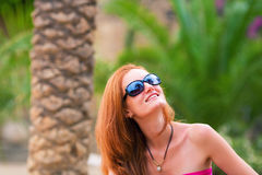 Happy girl on tropical resort Stock Photo