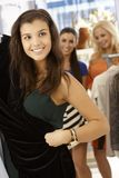Happy girl at clothes store Royalty Free Stock Photography