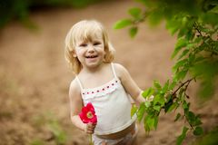 Happy girl with tulip Royalty Free Stock Photography