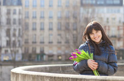 Happy girl with tulips Stock Photography