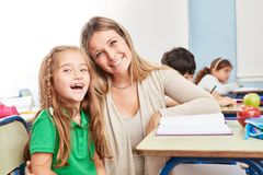 Happy girl with tutor tutor royalty free stock photography