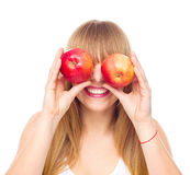 Happy girl with two apples Royalty Free Stock Image