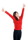 Happy Girl two hands thumbs up in red Royalty Free Stock Photos
