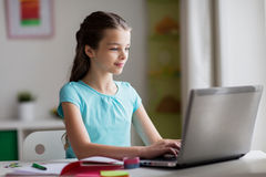 Happy girl typing on laptop at home Royalty Free Stock Photography