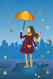 Happy girl with umbrella on the rainy city background. Rain and smiling girl with umbrella and cat in the coat pocket. Happy girl with umbrella on the rainy Royalty Free Stock Images