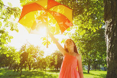 Happy girl with umbrella in sun royalty free stock image