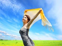 Happy girl under blue sky Royalty Free Stock Images