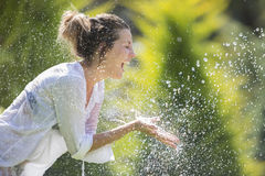 Happy girl under drops Royalty Free Stock Images