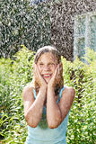 Happy girl under rain Stock Photos