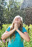 Happy girl under rain Royalty Free Stock Images