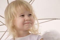 Happy girl under umbrella Stock Photo