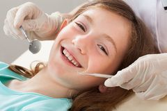 Happy girl undergoing dental treatment Royalty Free Stock Photo
