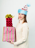 Happy girl in an unusual Christmas hat with gift boxes Stock Photo