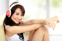 Happy girl using headphones Royalty Free Stock Photography