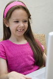 Happy Girl Using Laptop Royalty Free Stock Photography