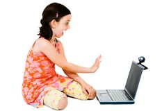 Happy girl using a laptop Royalty Free Stock Photography