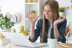 Happy girl using laptop Stock Photos