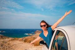 Happy girl on vacation travel by car. Summer holiday and car travel concept. Royalty Free Stock Photography