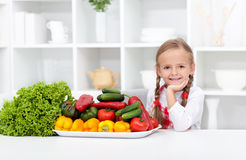 Happy girl with various vegetables Stock Photo