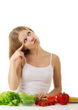 Happy girl, vegetarian food, vegetables in kitchen royalty free stock images
