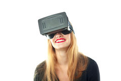 Happy girl in virtual reality helmet. Horizontal portrait of attractive happy girl in virtual reality glasses isolated on white background. VR helmet. third royalty free stock photos