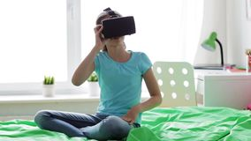 Happy girl in vr headset or 3d glasses at home stock video footage