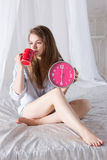 Happy girl  wake up with alarm clock and  coffee Royalty Free Stock Image