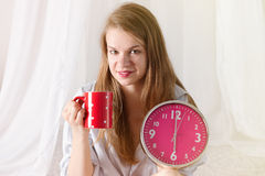 Happy girl  wake up with alarm clock and  coffee Stock Photos