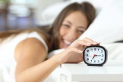Happy girl waking up in the morning Royalty Free Stock Images