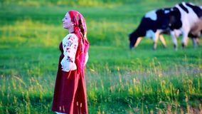 Happy girl walk on green grassland and sings Royalty Free Stock Image