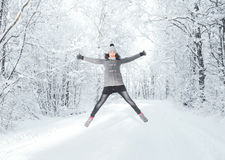 Happy girl walking in a beautiful winter forest Royalty Free Stock Image