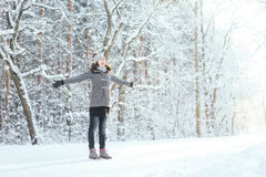 Happy girl walking in a beautiful winter forest Royalty Free Stock Images