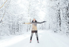 Happy girl walking in a beautiful winter forest. Happy girl walking in beautiful winter forest. Christmas concept Royalty Free Stock Photos
