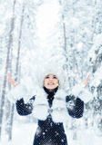 Happy girl walking in a beautiful winter forest Royalty Free Stock Photography