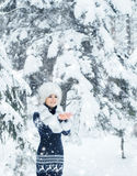 Happy girl walking in a beautiful winter forest Stock Image