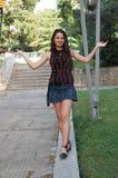 Happy girl walking in park Stock Photo