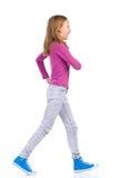 Happy girl walking Stock Photos