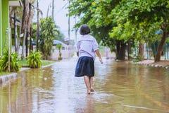Happy girl walking to flood. In school Stock Images