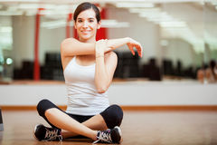 Happy girl warming up at a gym Stock Image