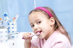 Happy girl washing her theet. Morning thooth wash, smile girl in bathroom Royalty Free Stock Images