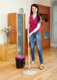 Happy  girl washing parquet floor Stock Photos