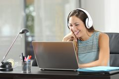 Free Happy Girl Watching Media Content On Laptop At Home Stock Photos - 137818243
