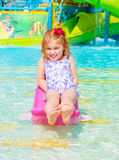 Happy girl on water attractions Royalty Free Stock Image